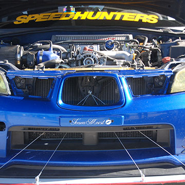 Sally McNulty's 2007 Subaru WRX time attack car features a 2006 Impreza WRX STI transmission and an STI turbo.
