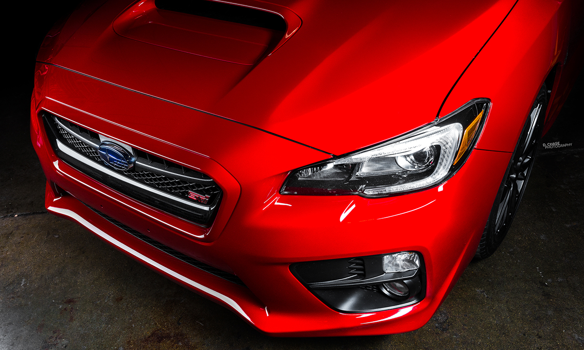 Exterior modifications include carbon fiber hood, trunk and front splitter painted to match to the pure red color.