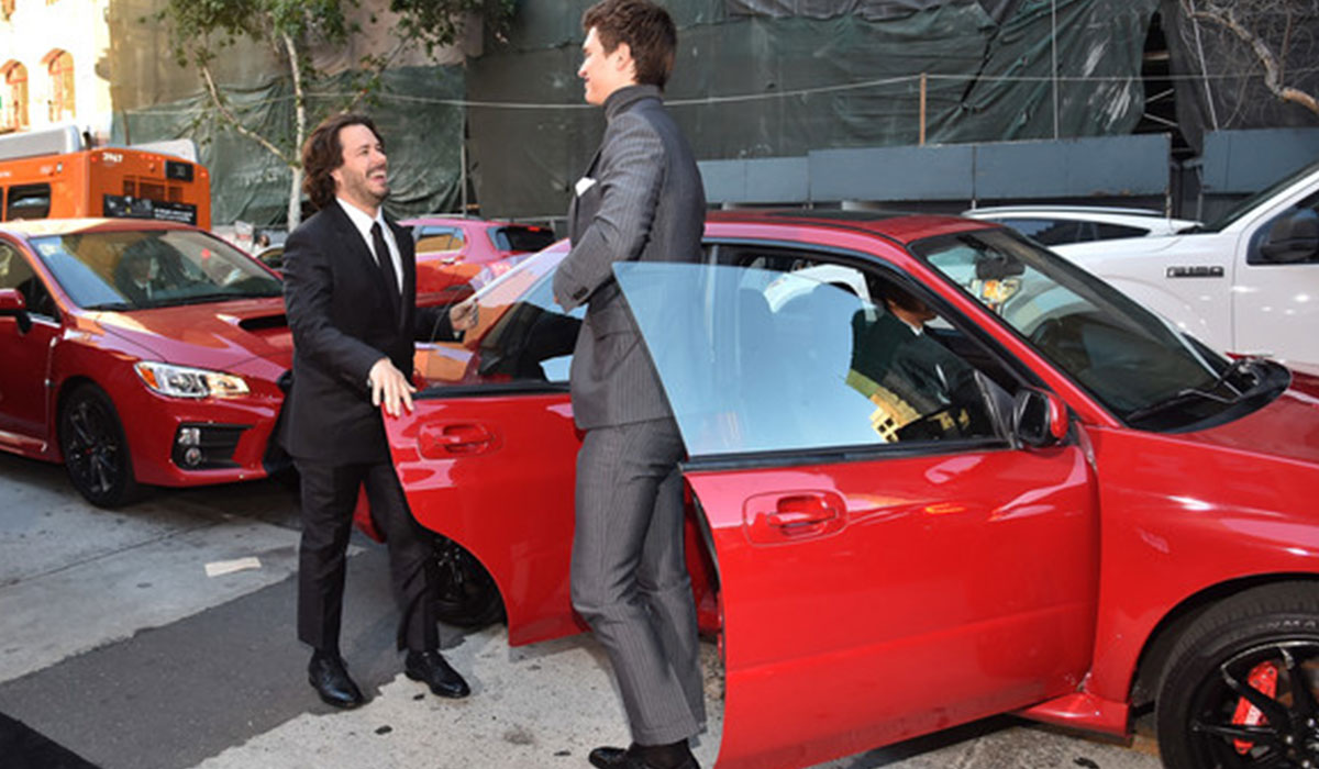 Director Edgar Wright and star Ansel Elgort share a laugh as they arrive on the red carpet.