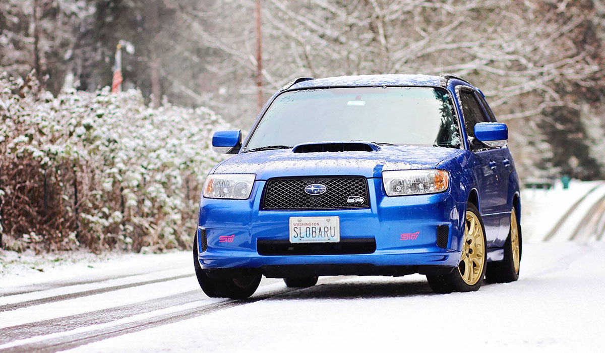 Jamie's daily driver – a 2007 Subaru Forester XT Sports – has undergone several mods, including a full coilover suspension, a Sport front lip spoiler, JDM rain guards, a full exhaust and a 4-pot (front) and 2-pot (rear) brake caliper swap.