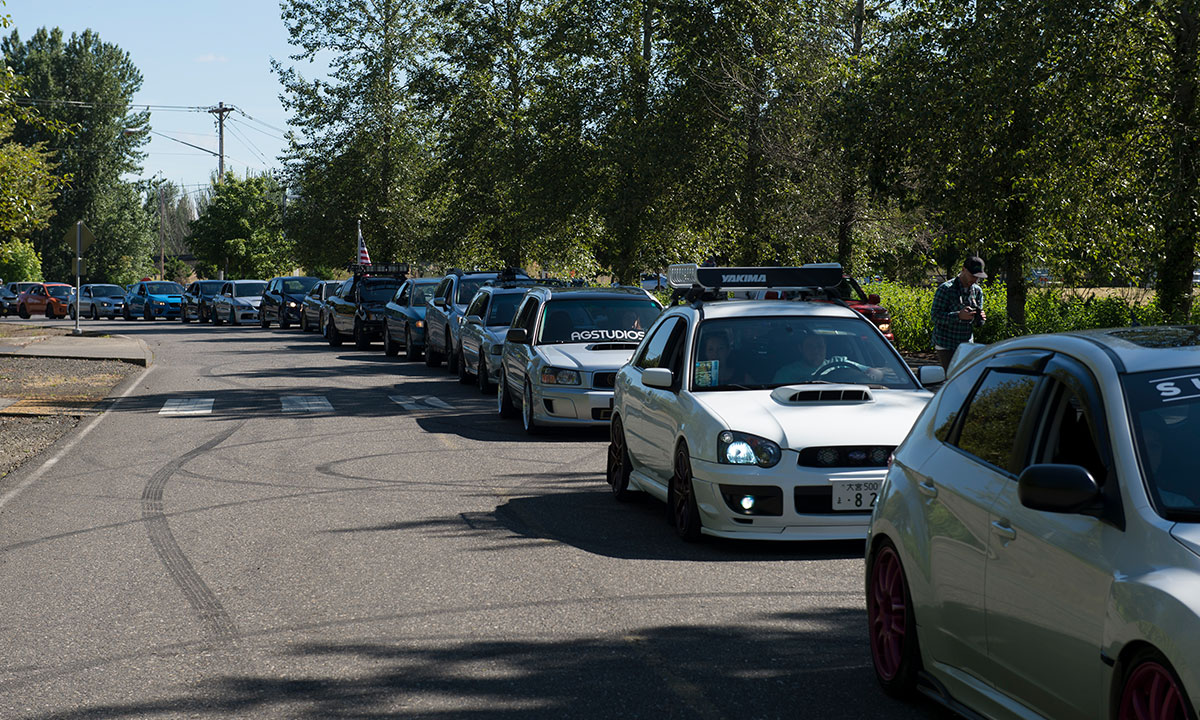 Subaru vehicles line up to get in to Big Northwest.