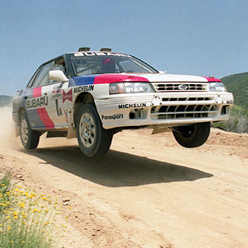 Chad DiMarco leaps over a jump in the 1992 Rim of the World Rally.