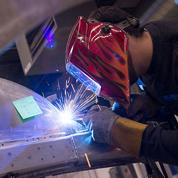 A welder works on a vehicle at Vermont SportsCar. There are currently more than 50 team members.