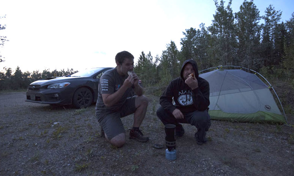 """After one of the most relentless, long, and enjoyable days of driving, those Freybe dogs tasted amazing,"" says Ben. ""However, with the bright 3 a.m. twilight flooding the tent, fears of our delicious smelling hot dogs attracting bears (there was discussion of where to dump the dog water), and the anticipation of making it to Anchorage via the Top of The World Highway on the next leg, sleep didn't come so easy."""