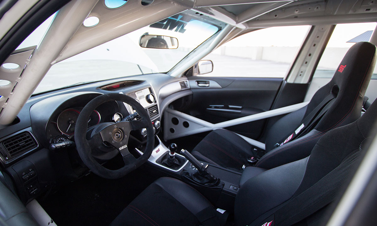 Inside, the major modifications include a full, rally-spec roll cage, a Sparco L360 steering wheel and DJ Safety Latch Style safety harnesses.