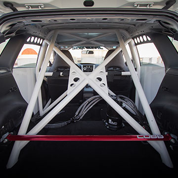 The roll cage is based on the SRTUSA WRX, welded to the rear suspension and engine bay.